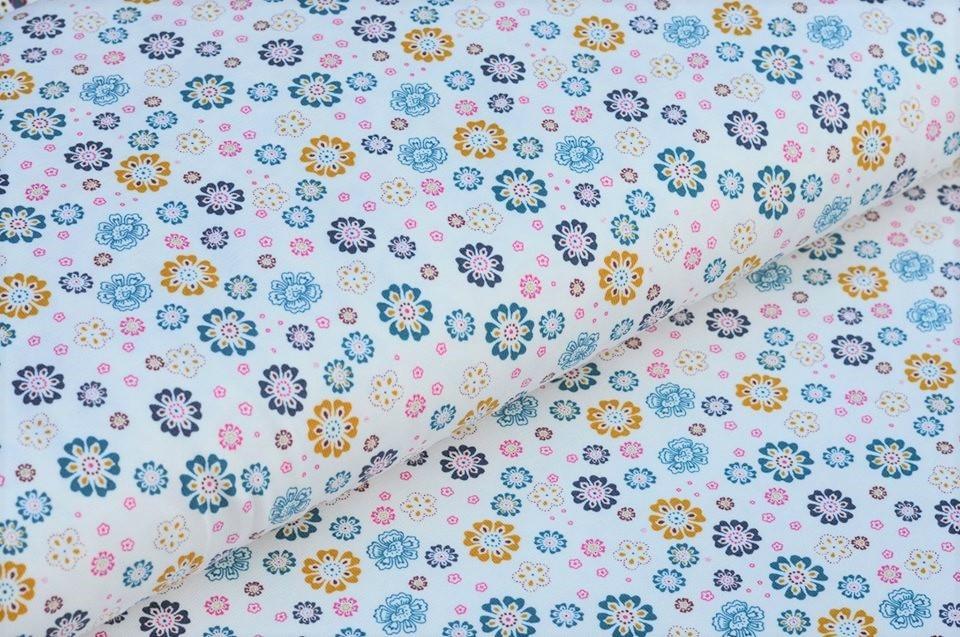 Baumwolljersey ecru mit vielen kleinen Blumen