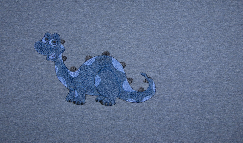 Baumwolljersey Panel jeansblau meliert mit gestickten Dinos