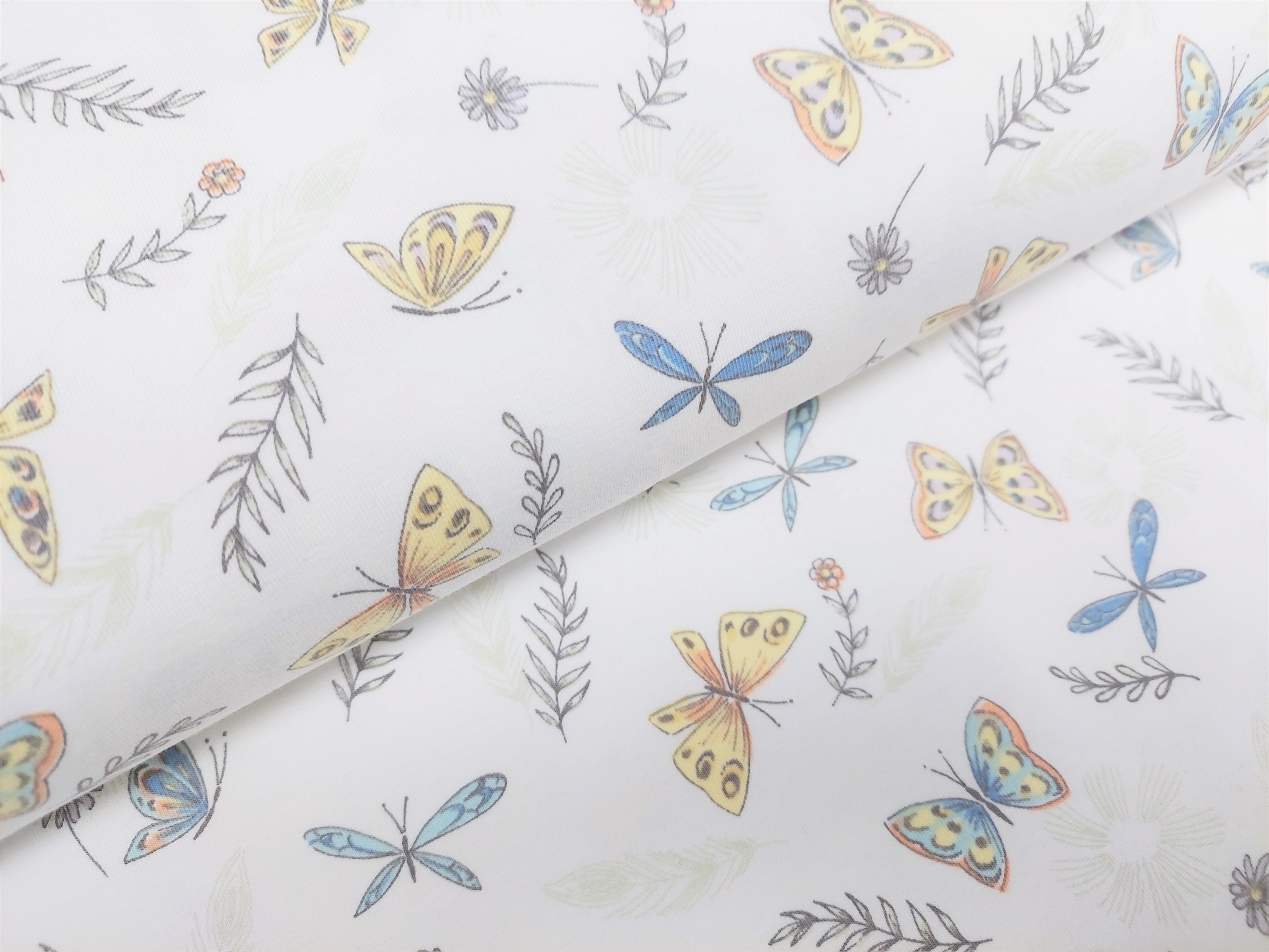Baumwolljersey ecru mit Schmetterlingen und Zweigen